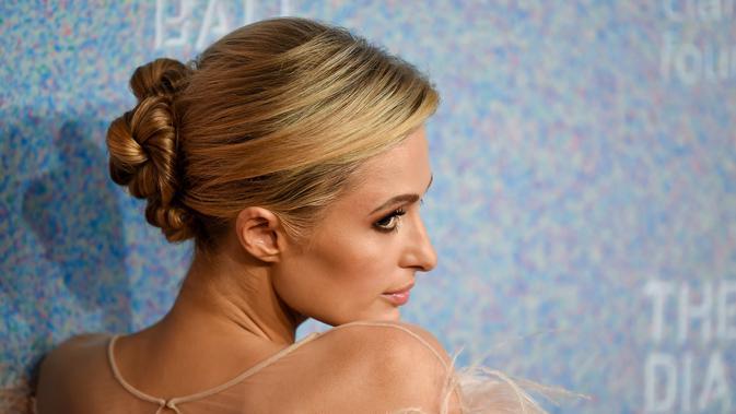Model dan sosialita Paris Hilton saat menghadiri Diamond Ball ke-4 di Cipriani Wall Street, New York, AS, Kamis (13/9). (Photo by Evan Agostini/Invision/AP)