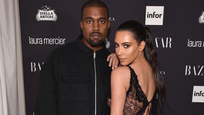 Kim Kardashian dan Kanye West. (Bryan Bedder / AFP)